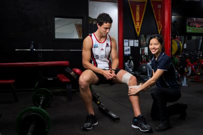 Shi Hui Wong at West Adelaide Football Club taping knee