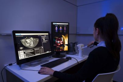 Medical sonography student using campus sonography simulator