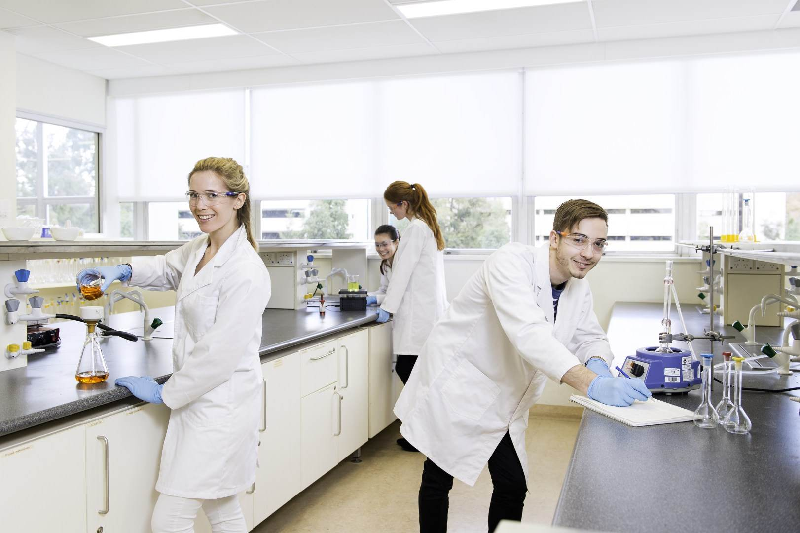 Pharmaceutical science students using campus laboratories