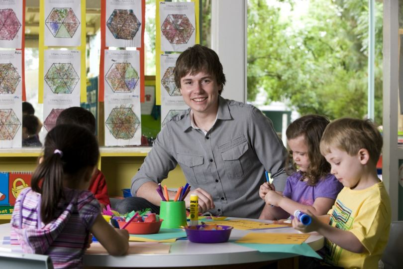 Early Childhood Teacher With Preschoolers In Clroom